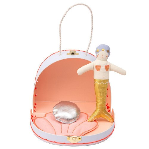 mermaid doll in suitcase